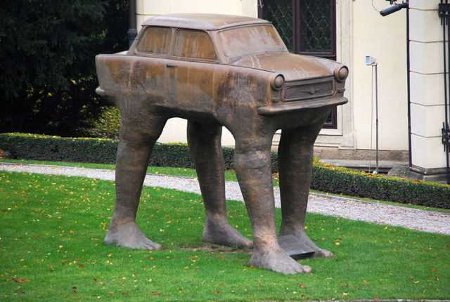 Sculpture of a Trabbi on legs at the German embassy in Prague